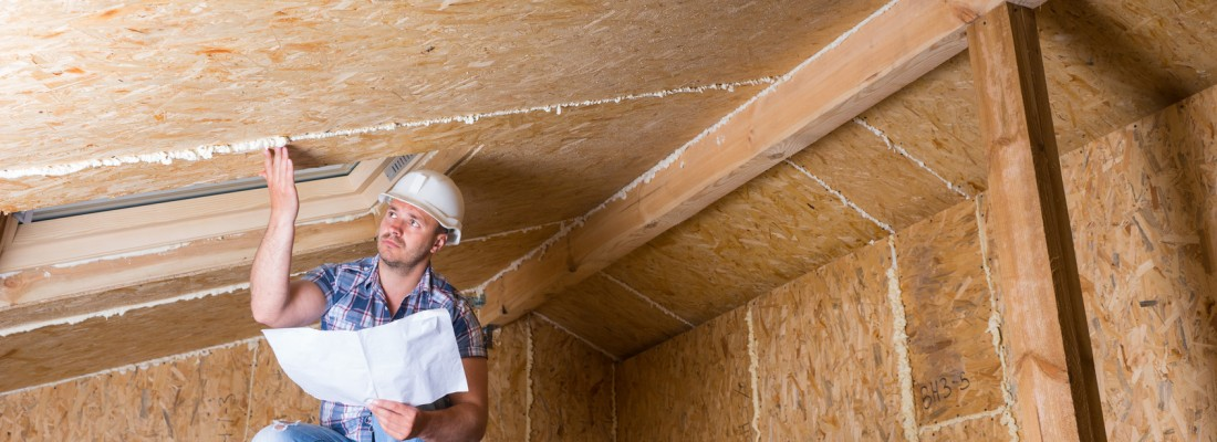 Builder Reading Plans Inside Unfinished Home
